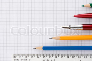 school supplies on checked background