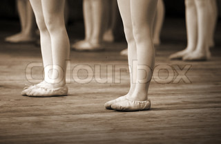 The ballet school fragment with little girls legs on pointes