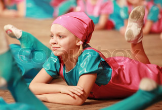 Little girl in modern dance on the stage of dancing performance
