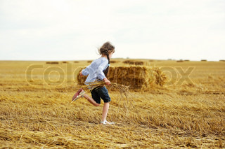 Little girl running around on a field