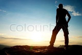 Silhouette of man in mountain