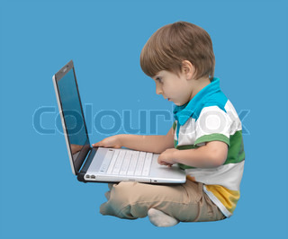Boy with laptop isolated on a blue background