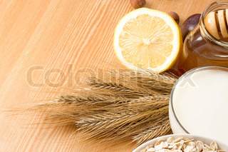 honey, milk, oat, lemon and grain on table