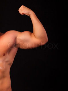 Strong arm of an athlete, isolated on black background