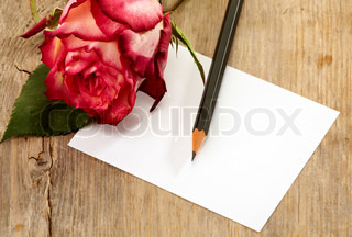 Paper note and rose