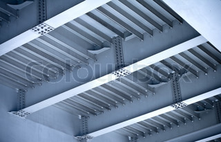 Elements of modern steel automotive bridge construction Beams and bolts steel structure on the bottom of bridge span