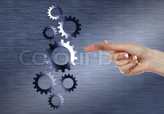Image with machinery gears and human hand
