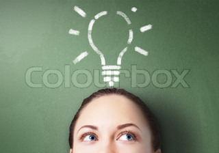 Young businesswoman with lightbulb as symbol of business creativity