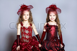 Portrait of two little girls in beautiful dresses