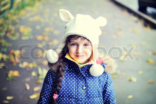Portrait of cheerful child girl in white hat