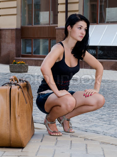 Beautiful Stock Image Of 39Young Woman In Mini Skirt And Blouse Squatting Rises