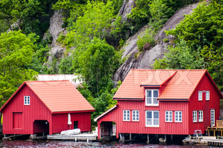 Two red houses stock photo colourbox - The house on the rock the ultimate refuge in a norwegian fjord ...