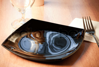 An empty black plate