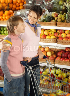 Funny boy with mom in the store