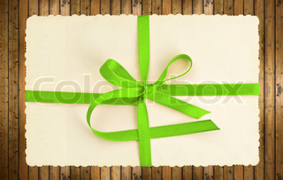 vintage gift card with green ribbon
