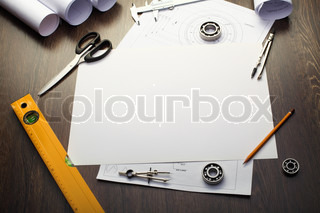 Tools and papers with sketches on the table