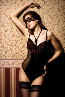 Fashion shoot of beautiful woman in luxury lingerie over vintage background
