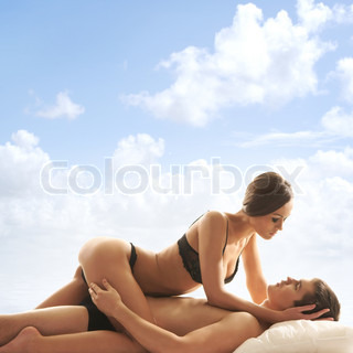 Young loving couple over sky background