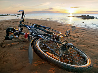 Bicycle lying on the beach