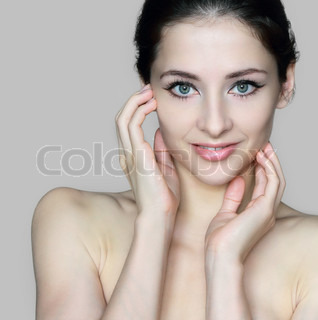 Beauty face of young beautiful woman touching hands the healthy skin isolated