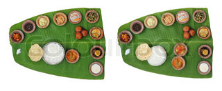 Sumptuous and wholesome onam meals called sadhya in kerala The lunch contains varieties of curries and vegetable mixes along with papad, sweet appam and kheer The food is served on a banana leaf