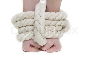 tied up female hands over white
