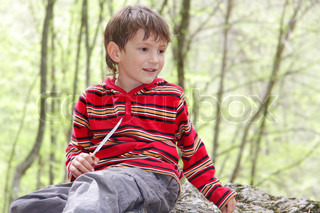 young boy on natural background