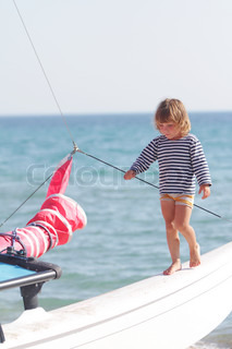 young happy child on ship on sea background
