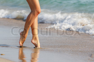 young woman walking by beach