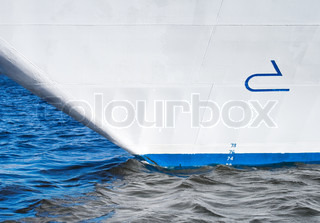 Bow of modern cruise ship with bulbous design sign and draft scale digits