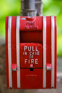 Red fire alarm hanging outdoors
