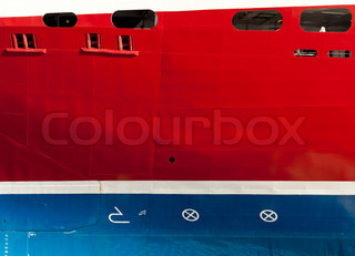 Texture of the cruise ship hull with waterline, draft scale numbering bulb and maneuvering propulsion devices signs