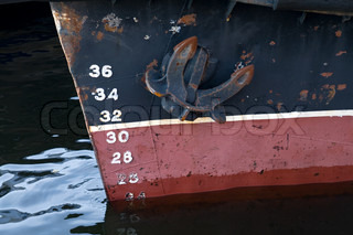 Bow of the cargo ship with anchor and draft scale numbering