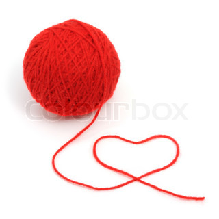Red yarn with heart symbol