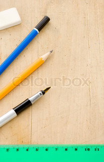 Pen, pencil and ruler on wood texture | Stock Photo ...