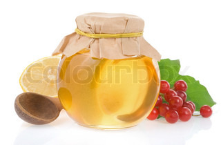 jar of honey and fruit isolated