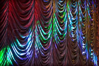 Illuminated colorful curtain background texture