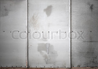 Gray metal wall with screws background texture
