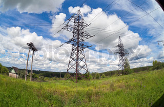 Electric power lines on a blue sky background and clouds.