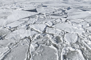 Blocks of ice on frozen lake Background texture