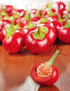Cut round hot chilly pepper on a table
