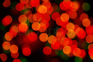 Abstract christmas lights as background on black