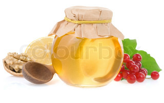 honey and fruit isolated on white