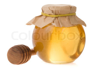 pot full of honey and stick