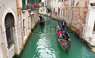 City canal with gondolas in Venice, Italy.