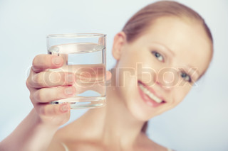 young healthy woman and a glass of clean water