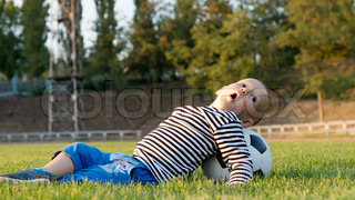 Small boy playing with a soccer ball