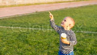 Little boy pointing at the sky