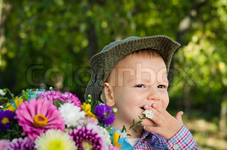 Little boy with bouquet of flowers