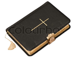 old black bible book on white background
